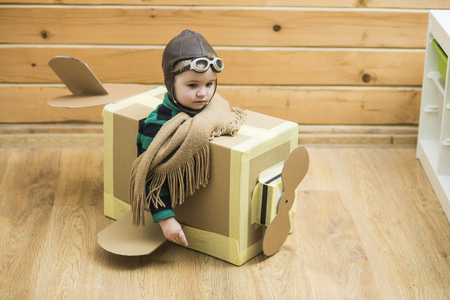 Little Child Playing Airplane Pilot, Kid Traveler Flying in Aviator Helmet, Travel, Vacation Trip Concept
