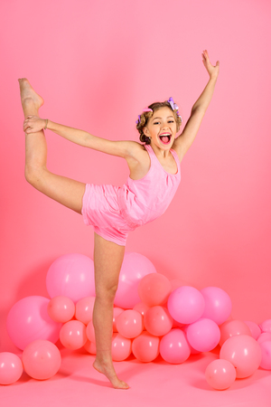yoga, little girl gymnast in balloons. yoga and pilates. 免版税图像