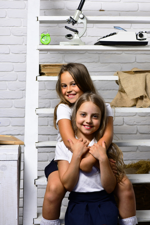 school. happy friends girls embrace in school classroom Banque d'images