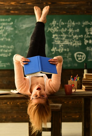 Teacher is warm accessible enthusiastic and caring, Teacher is sitting at the table in classroom, Teachers who become great or master teachers seek out the help they need,