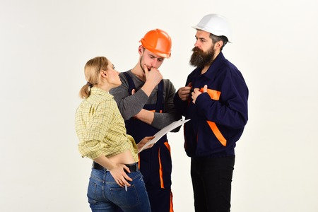 Woman amend plan of repair. Brigade of workers, builders in helmets, repairers, lady arguing, discussing contract, white background. Supervisor not satisfied with renovation. Misunderstanding concept.