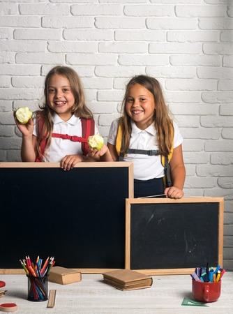 blackboard in hands of happy little kids. blackboard for copy space at school lesson. Stock Photo