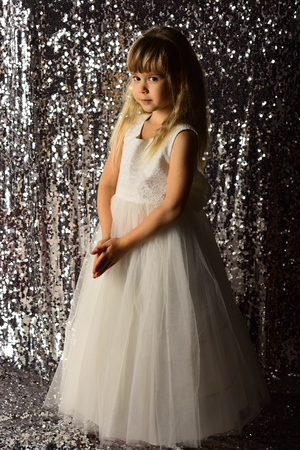 Little girl in fashionable dress, prom. little girl in glamour style.