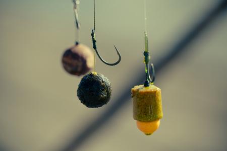 Hook, fishing baits, closeup, floating baits for fish. Baits for carp. Fishing gear. Stock Photo