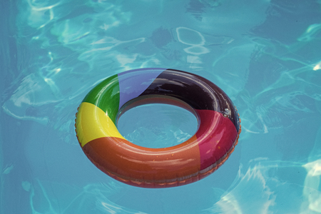 inflatable ring float in pool blue water. Summer vacation and travel to ocean, Bahamas. Maldives or Miami beach. Relax in spa luxury swimming pool. colorful swim ring