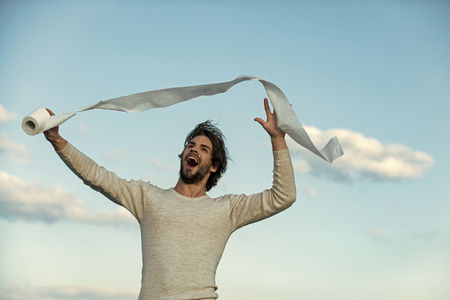 Man with happy face hold toilet paper, single. Stock Photo