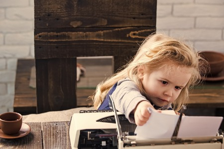 kid or small boy or businessman child with typewriter Banco de Imagens