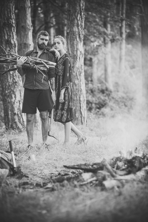 Couple in love make bonfire in forest Stock Photo