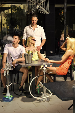 twins women and men friends relax in cafe outdoor