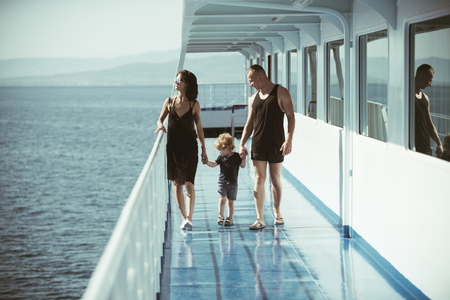 mother and father with their children travel on ship