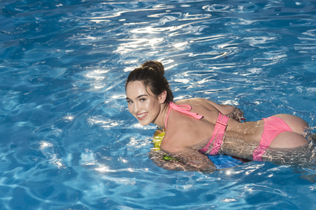 Summer vacation and travel to ocean, Bahamas. Maldives or Miami beach. Sexy woman on sea with inflatable ring. Fashion and beauty of woman with natural makeup. Relax in spa luxury swimming pool. Imagens