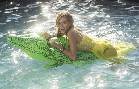 Adventures of girl on crocodile. Sexy woman on sea with inflatable mattress. Relax in luxury swimming pool. Summer vacation and travel to ocean, maldives. Fashion crocodile leather and girl in water. Banque d'images - 101171722
