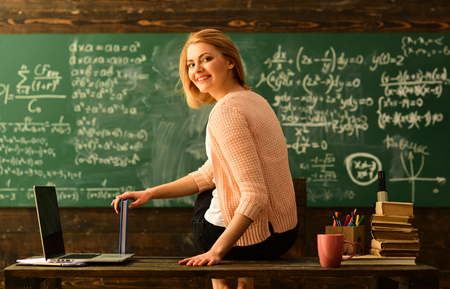 Teacher is skilled leader, Student looks for studying method that suits his learning style, Modern teacher hipster writing on big blackboard with math formula, Some students learn best by listening, 写真素材 - 101172152