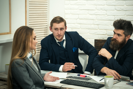 Business partners, businessmen at meeting, office background. Business negotiations, bosses listening with interest business offer. Businesswoman ask for investment. Business investment concept. Banque d'images - 101172156