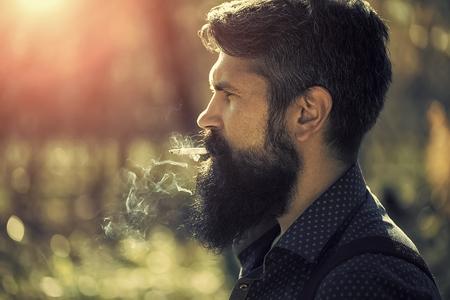 Smoking man in forest