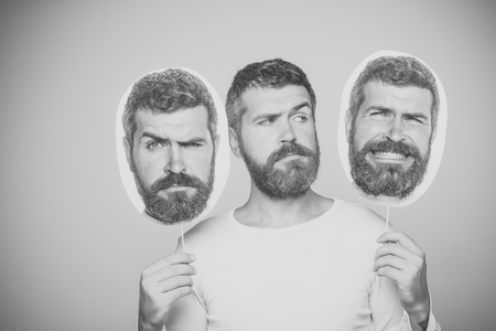 man with long beard on sad face hold paper nameplate Stockfoto