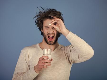 Man drink pill with water, illness, insomnia. Stock Photo