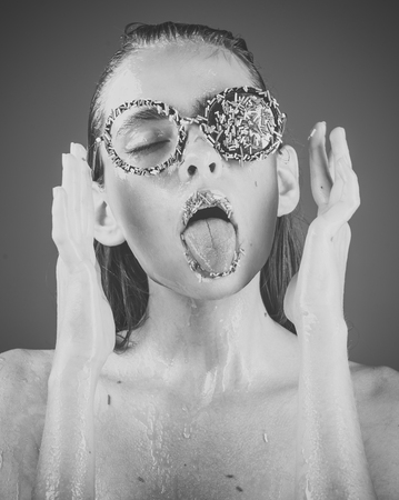 Makeup of sugar candy kiss on lips. Beauty and fashion model of glamour girl. Sprinkles lipstick and glasses on girl, valentines day. Young woman with sprinkles makeup. Diet and sweet dessert, easter Banco de Imagens