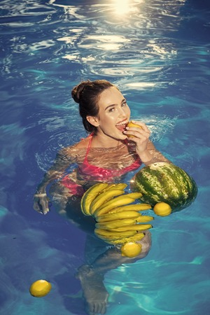 Vitamin in fruit at girl near water. vitamin and healthy organic food.