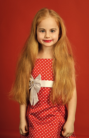Fashion and beauty, pinup style, childhood. Retro look, hairdresser, makeup. Retro girl or fashion model, beauty. Little girl in vintage dress, prom. Child girl in stylish glamour elegant dress.
