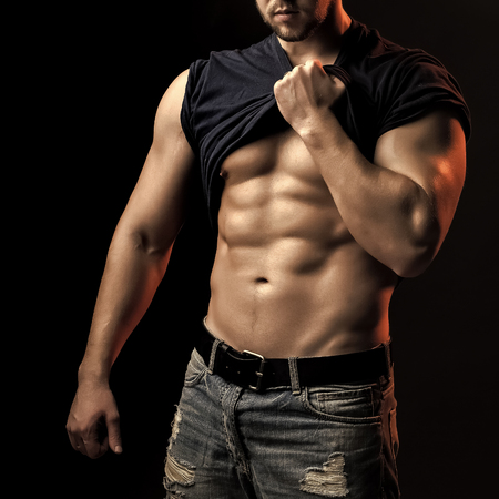 Muscular man with shirt on shoulder Stockfoto - 100825803