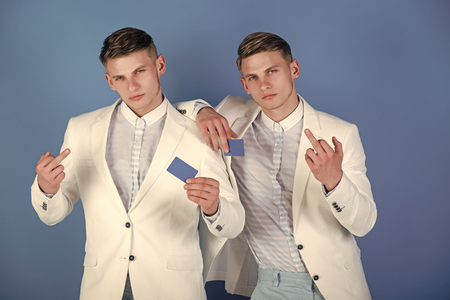 Businessmen showing middle fingers in white jackets 写真素材