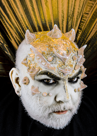 Head with thorns or warts, face covered with glitters, close up. Fantasy concept. Stock Photo