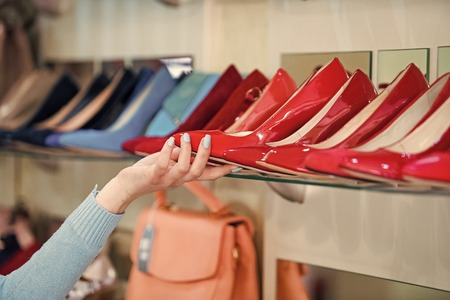 shopping showcase with female footwear and hand Stock Photo