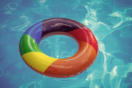 colorful swim ring or lifebuoy. inflatable ring float in pool blue water. Summer vacation and travel to ocean, Bahamas. Maldives or Miami beach. Relax in spa luxury swimming pool Stockfoto - 101120780