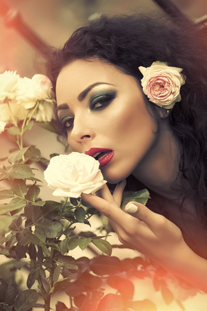 Portrait of adorable woman with rose in hair