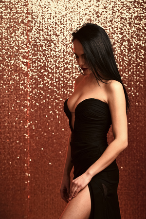 Woman in black evening dress with cleavage