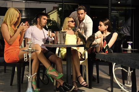 Man vapor hookah pipe in shisha bar lounge