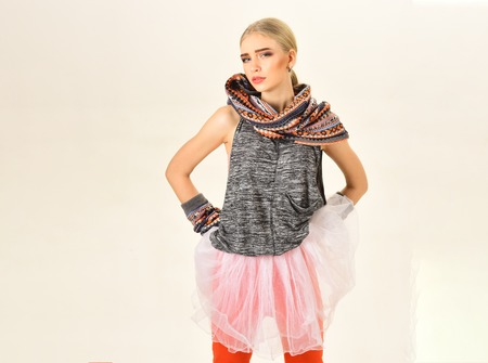 Blond model with neat ponytail and bright make-up isolated on white background. Boho style fashion. 写真素材