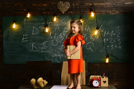 Child needs to stay focused to finish her work.Pupil is having one-on-one time with his instructor. Teacher helping pupil in classroom at the elementary school. Lesson with qualified private tutor.