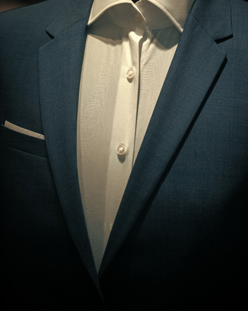 Part of formal male garment, close up. Classic jacket with white shirt made out of high quality textile, luxury clothes. Official style of clothing, dress code. Business clothing. Menswear concept. Foto de archivo - 101185493