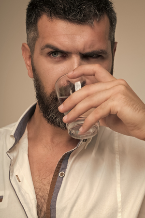 Bearded hipster drink water 写真素材