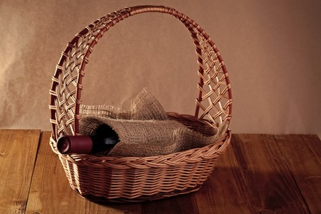 Basket with bottle of wine