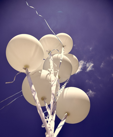 Air balloons on ribbon. Stock Photo