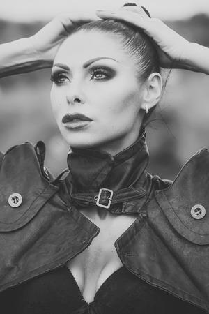 Woman in leather biker jacket