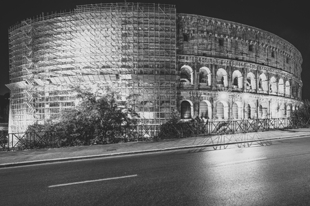 Colosseum with scaffolding under restoration at night Rome, Italy