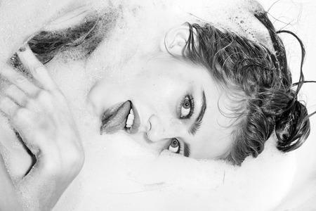 Playful woman in bath