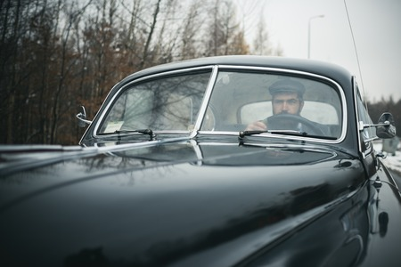 Escort man or security guard. Travel and business trip or hitch hiking. Bearded man in car. Call boy in vintage auto. Retro collection car and auto repair by mechanic driver. Stock fotó