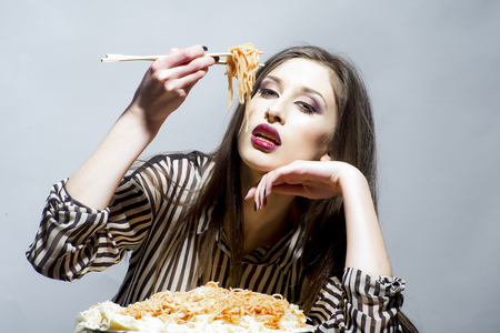 Girl eat pasta dish with tomato ketchup. Girl have italian food meal. Archivio Fotografico - 104296219