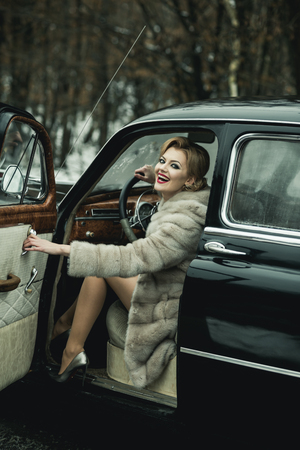 Call girl in vintage car. call girl with stylish hair and fashionable makeup Stock fotó