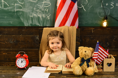Student woman holding USA flag. Child and demonstrating openness is must for tutor. Pupil is having one-on-one time with his instructor. Elegant man on the background with flag of the USA. Stok Fotoğraf - 101721224
