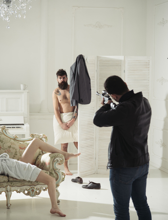 Husband arrived home to see wife cheat with lover. Husband with gun to shoot hipster. Stock Photo