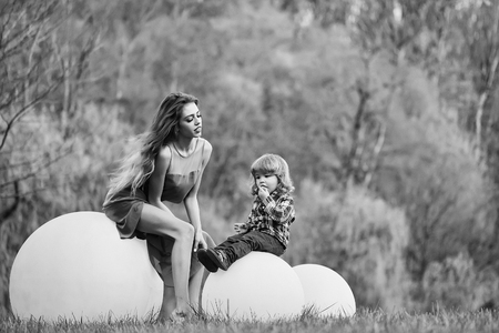 Woman and boy with bog ball