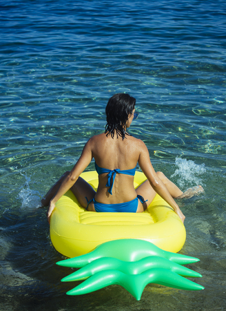 Woman relaxing in a pool or sea water Stock Photo