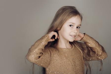 little girl on grey studio background, copy space Foto de archivo - 105502044