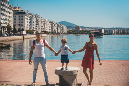 Family travel with kid on mothers or fathers day. family on summer vacation